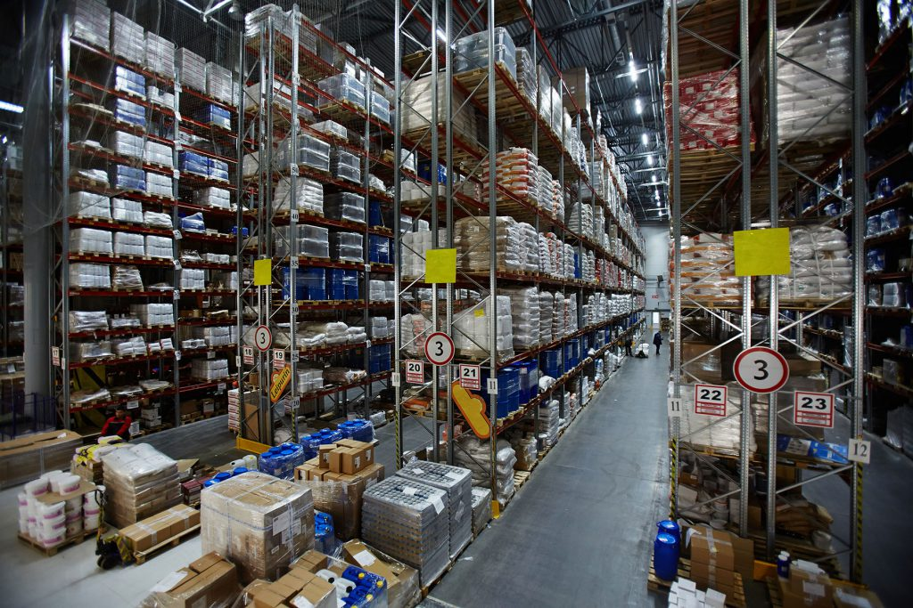 Modern warehouse with lots of packed goods on shelves